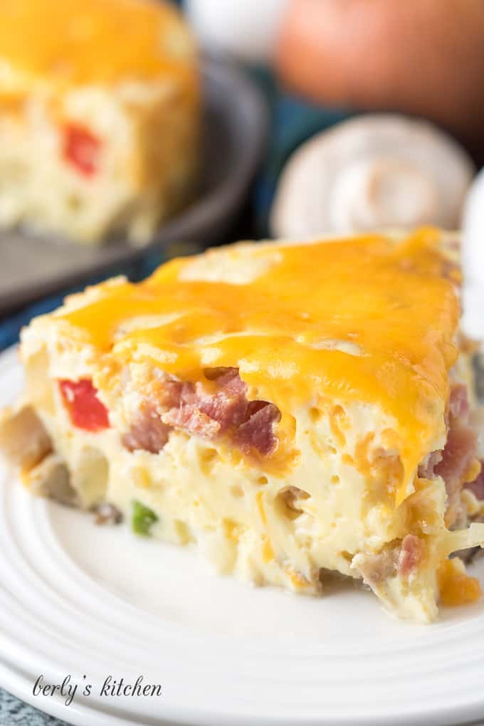 A piece of the Instant Pot frittata topped with melted cheese.