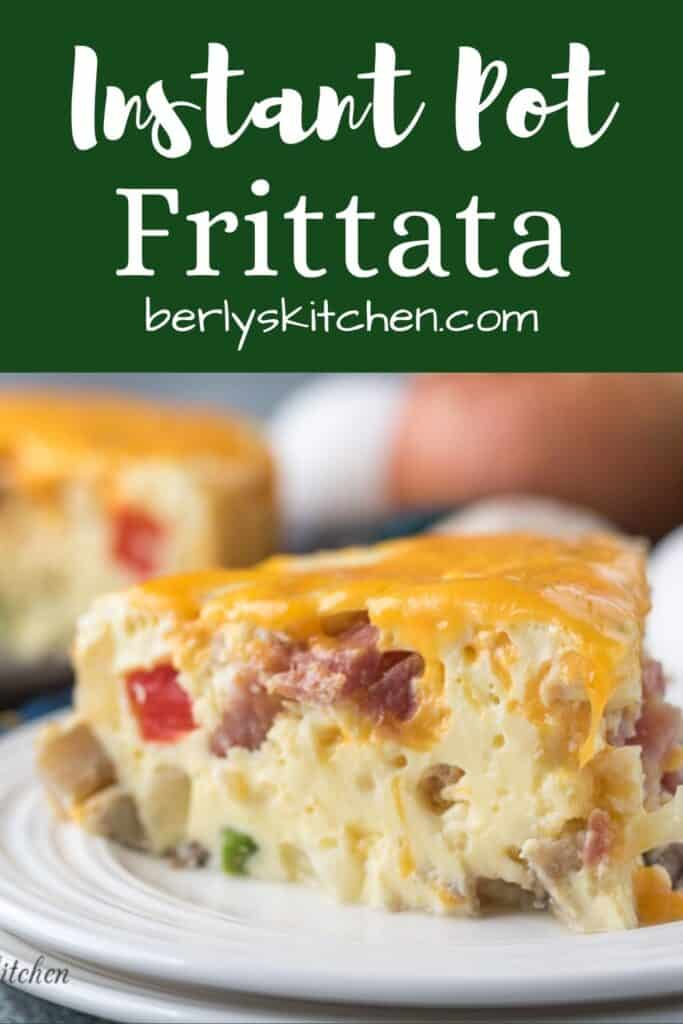 A piece of the ham frittata topped with melted cheddar.