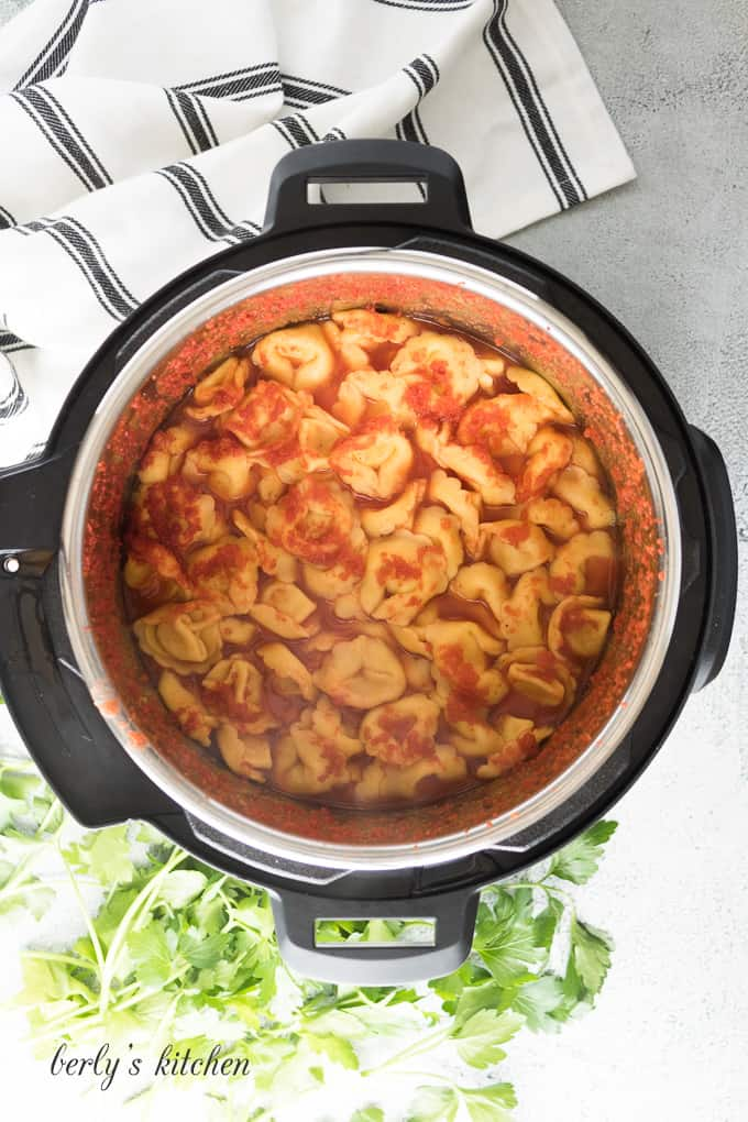 The pasta and tomatoes have pressure cooked in the liner.