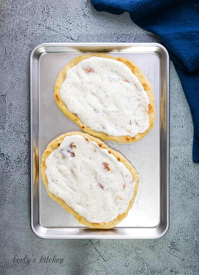 Ranch dressing spread evenly over the flatbread.