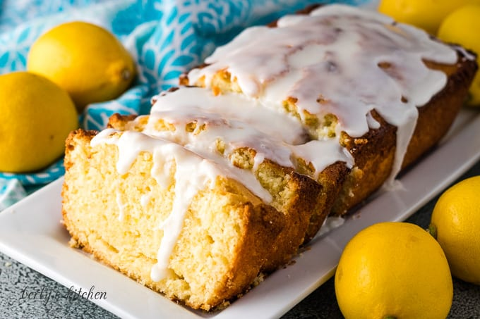 The sliced lemon quick bread drizzled with glaze.