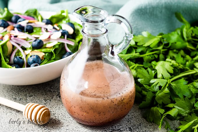 The poppy seed salad dressing in a dressing bottle.