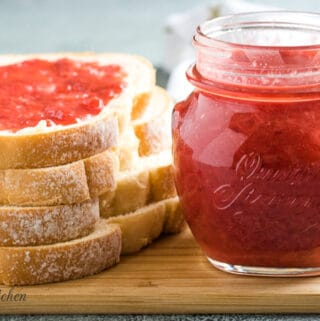 The finished strawberry jam on toast and a mason jar.