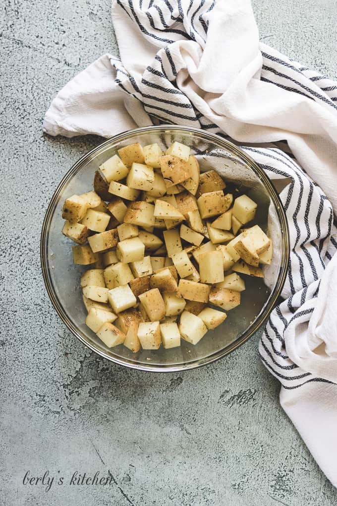 The potatoes have been tossed with olive oil and spices.