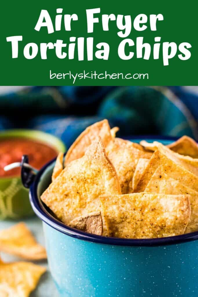 The air fryer tortilla chips served in a decorative kettle.