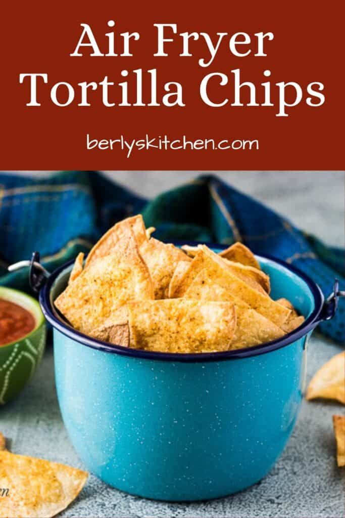 A blue kettle with wire handle filled with air fryer tortilla chips.