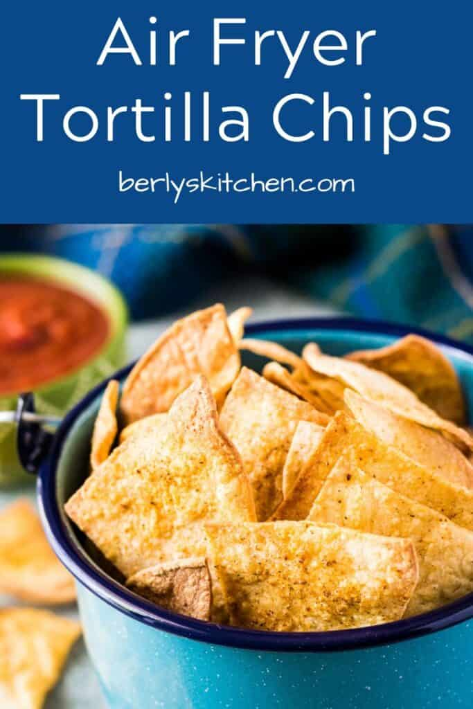 Air fryer tortilla chips sprinkled with seasoned salt.