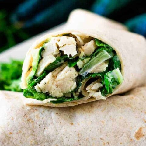 A close-up of a sliced chicken wrap showing the filling.