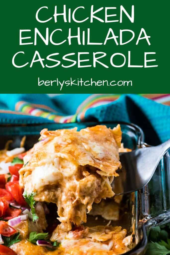 A slice of the layered chicken enchilada casserole being lifted from the baking dish.