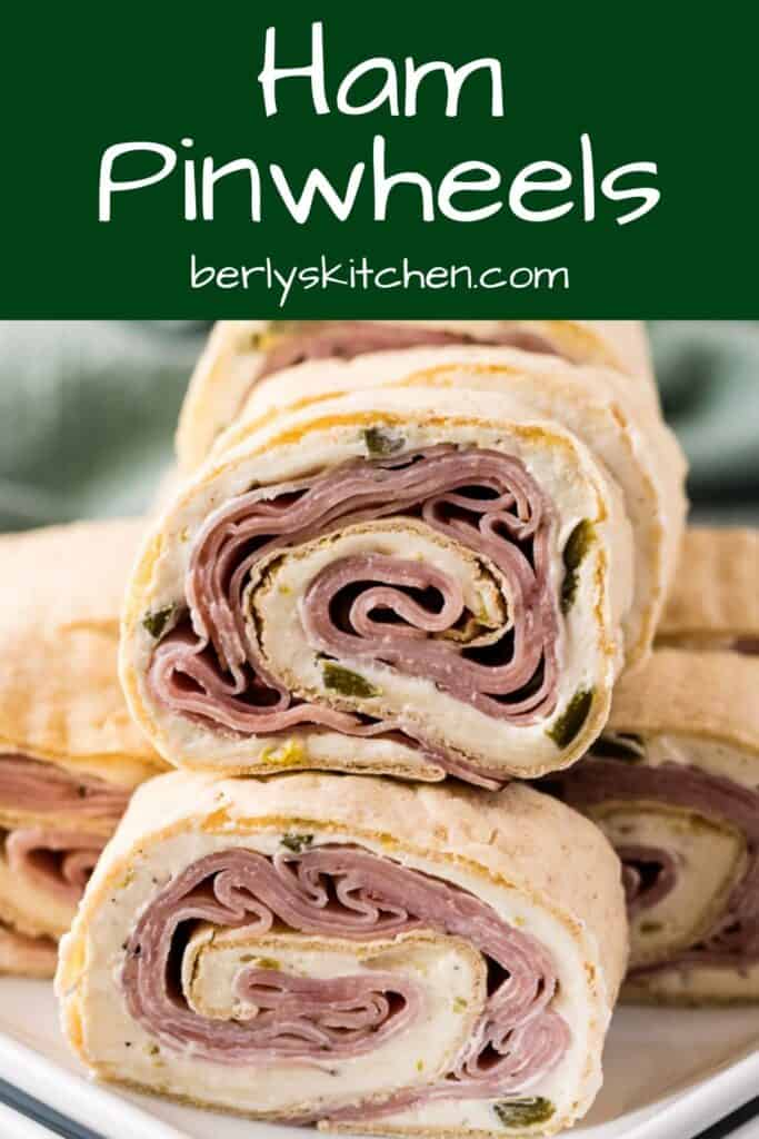 A stack of the ham and cream cheese pinwheels on a plate.