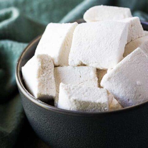 The square marshmallows served in a bowl.