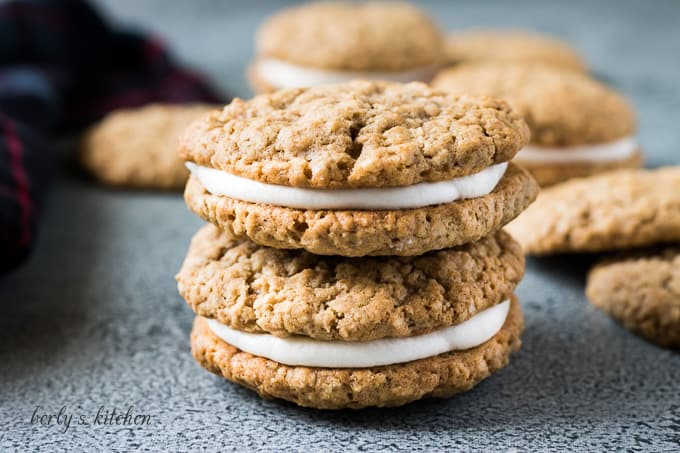 Two stacked oatmeal whoopie pies on the counter.