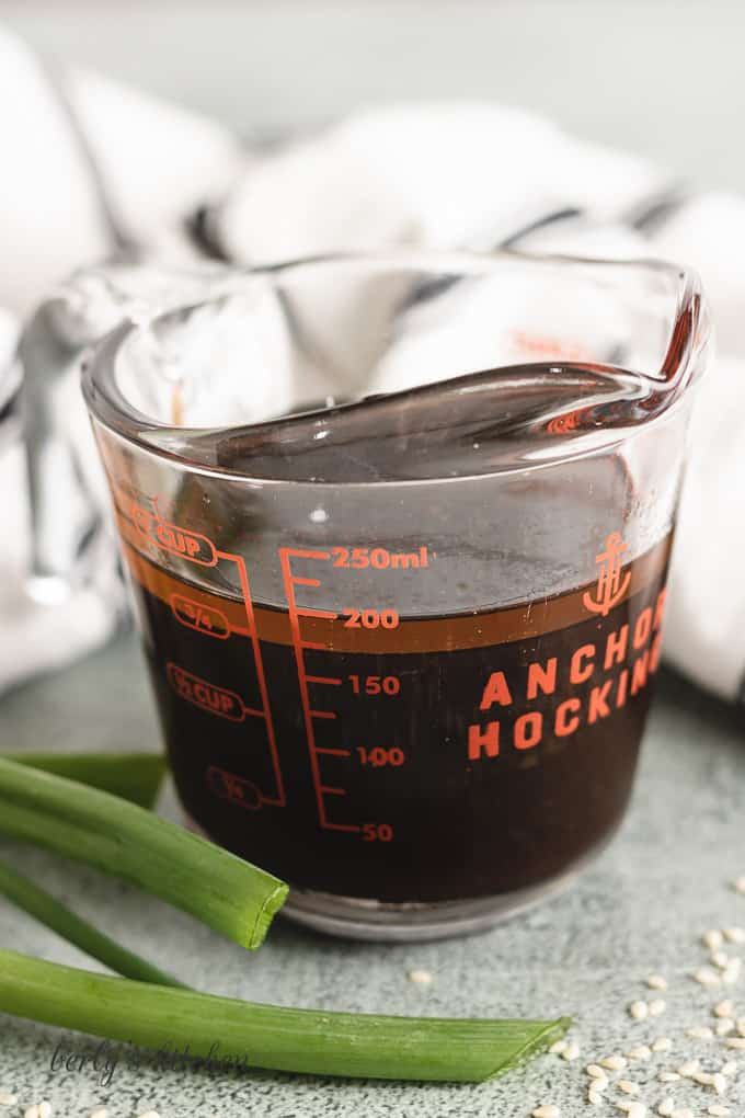 Soy sauce and other ingredients in a measuring cup.