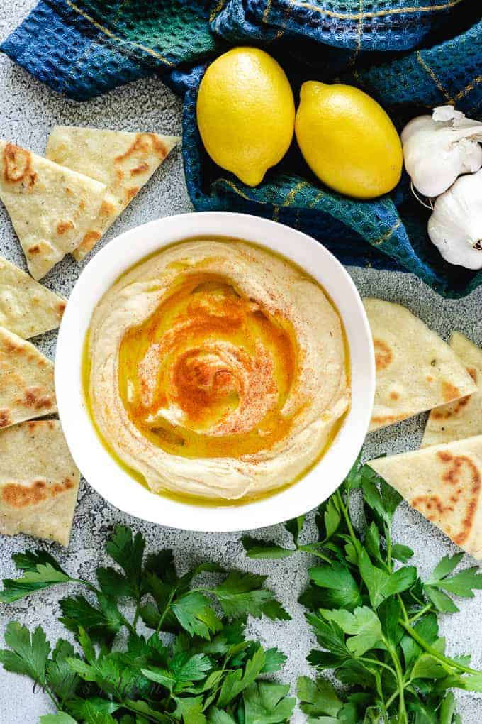 An aerial view of the roasted garlic hummus served with flatbread.