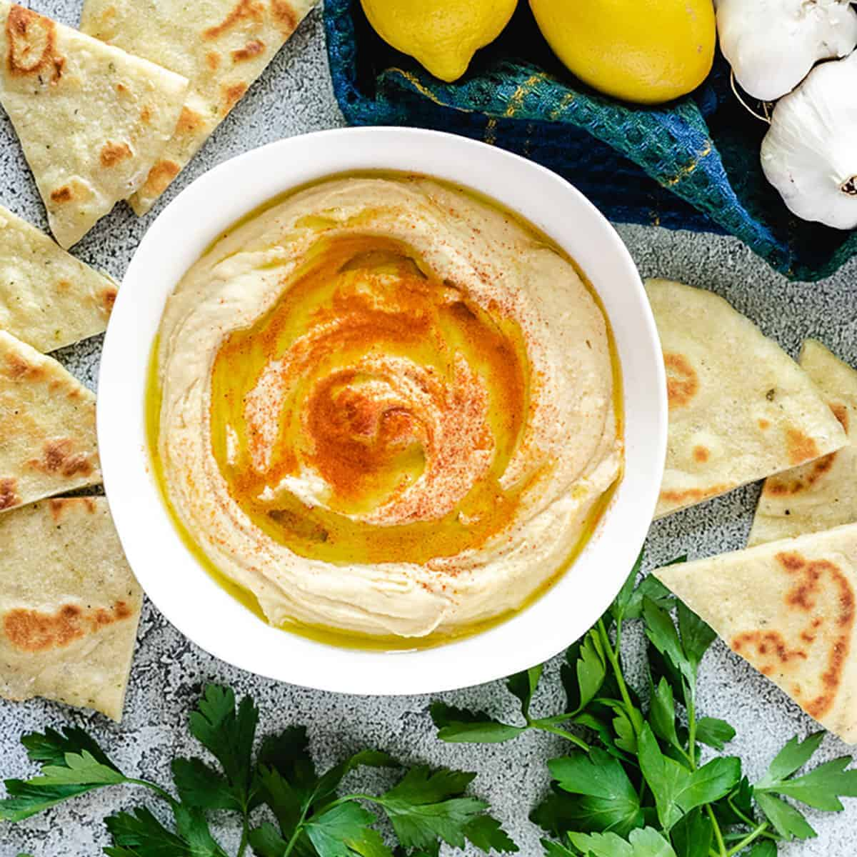 An aerial shot of the roasted garlic hummus served with flatbread.
