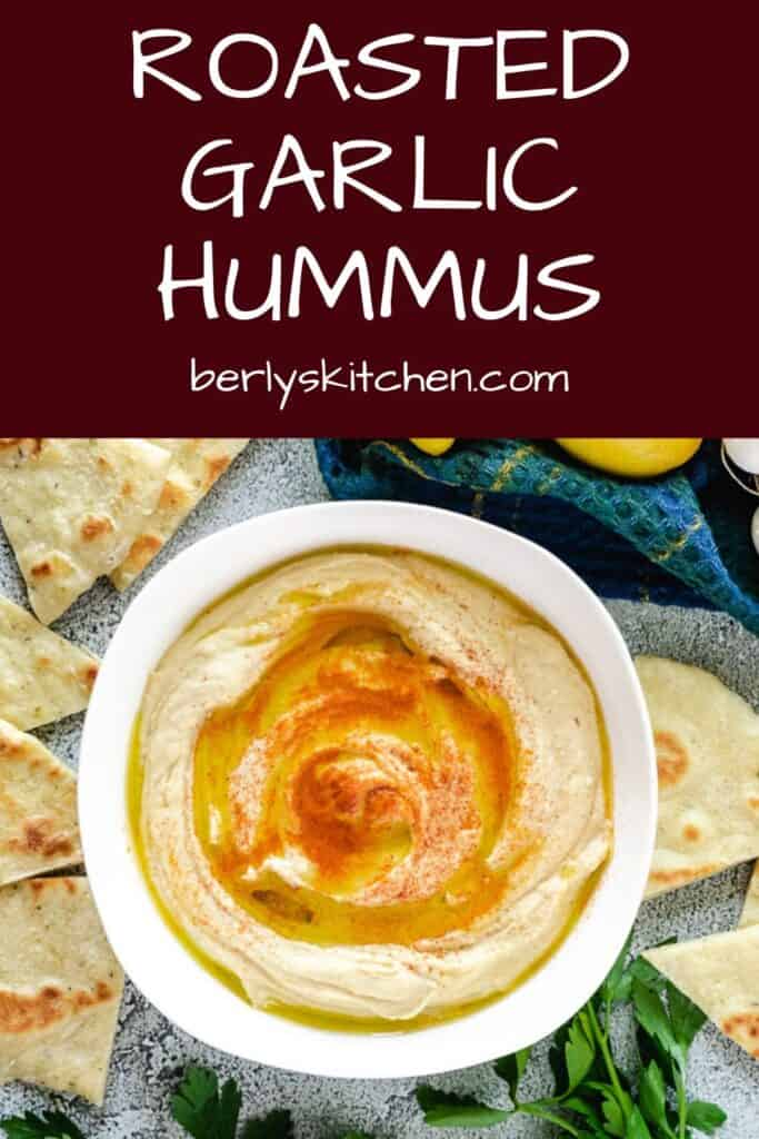A top-down view of the roasted garlic hummus topped with smoked paprika.