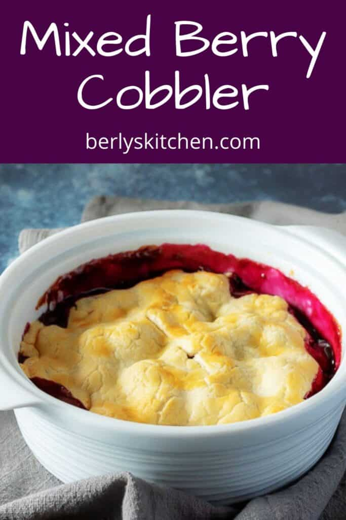 The baked mixed berry cobbler in large baking dish.