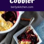 A serving of the mixed berry cobbler in a square bowl.