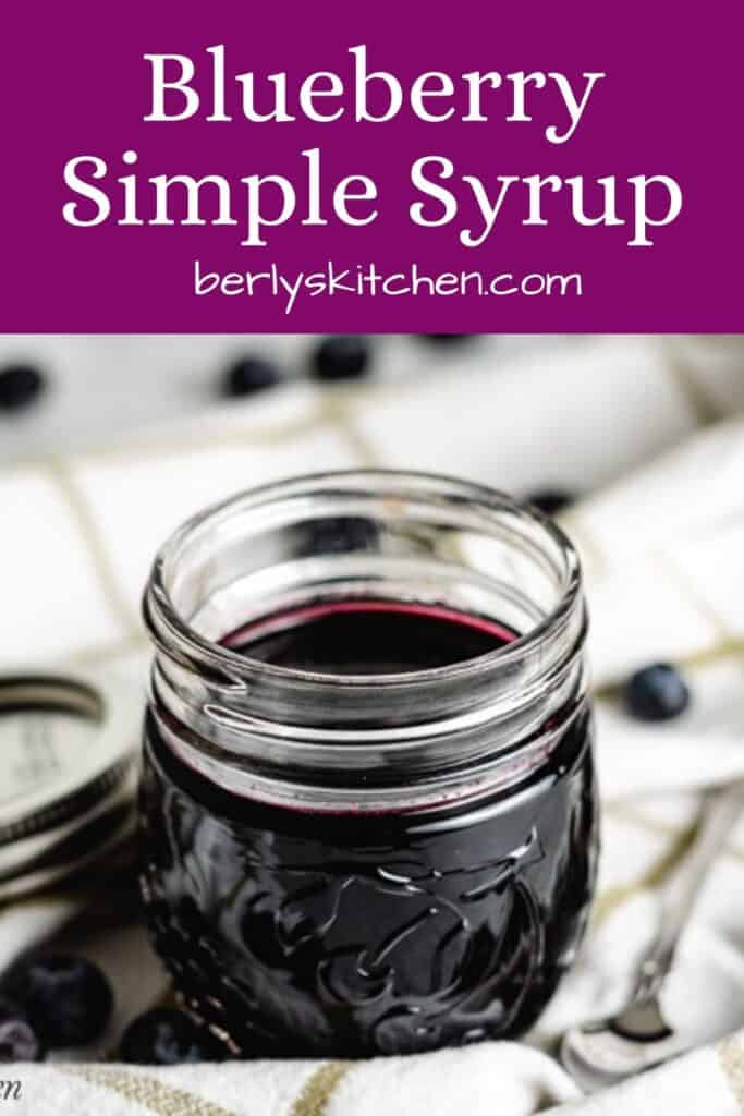 The finished blueberry simple syrup in a jar.