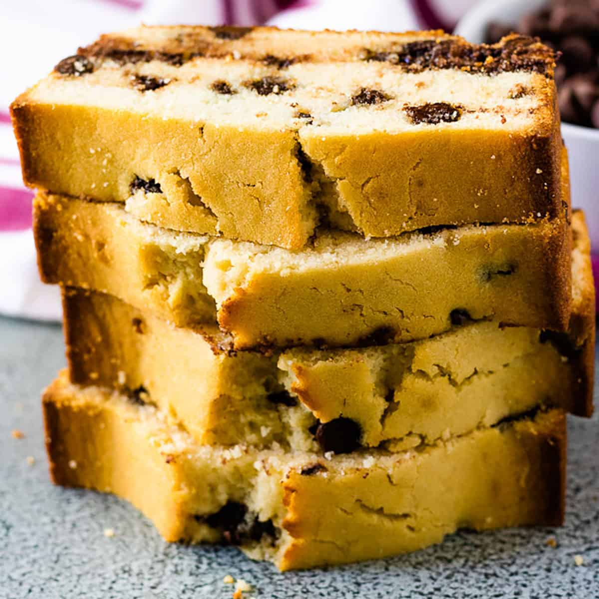 Stack of slices of chocolate chip loaf cake.
