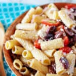The pasta salad served in a decorative wooden bowl.