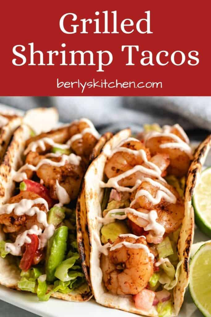 A close-up of the grilled shrimp tacos topped with chipotle cream sauce.