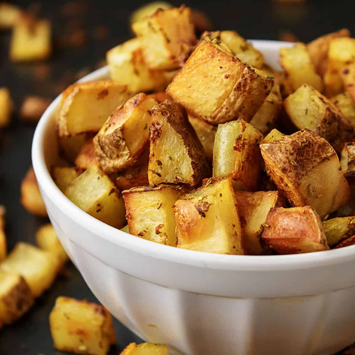 White bowl with oven baked home fries.