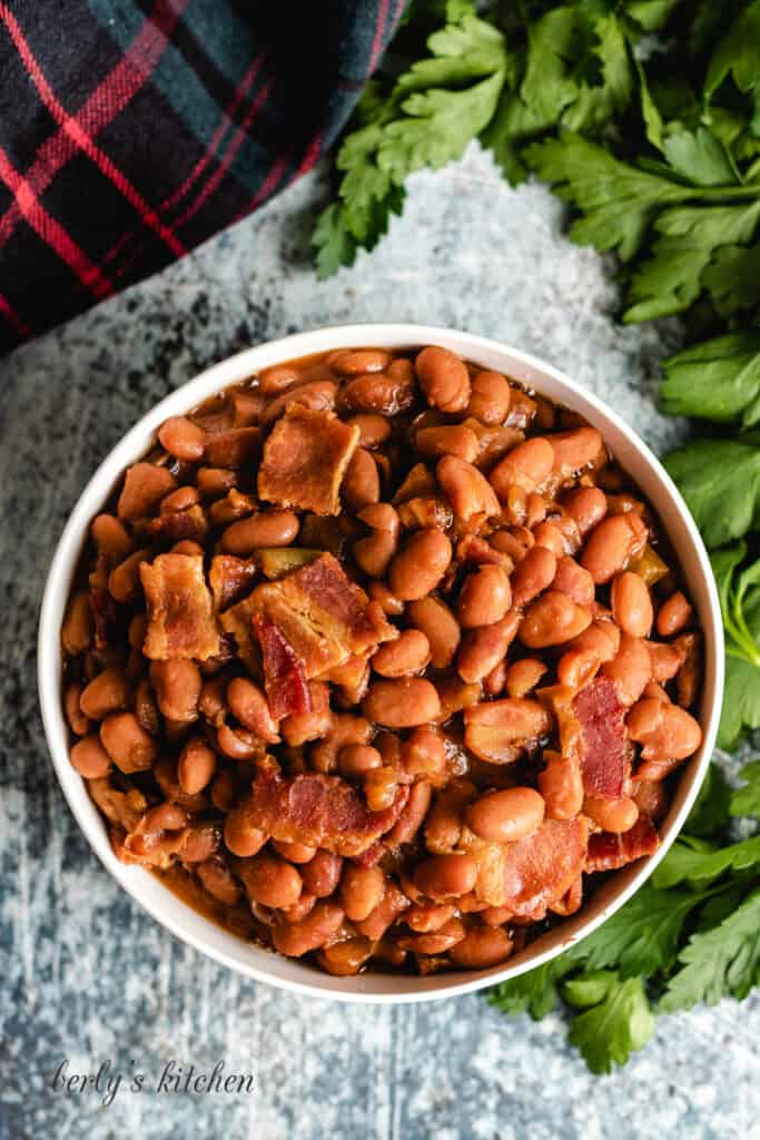 Top-down photo of the finished beans topped with bacon.