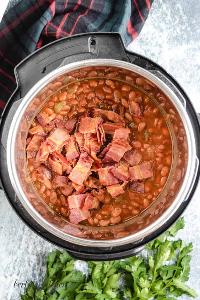 Everything has cooked and bacon has been added to the beans.