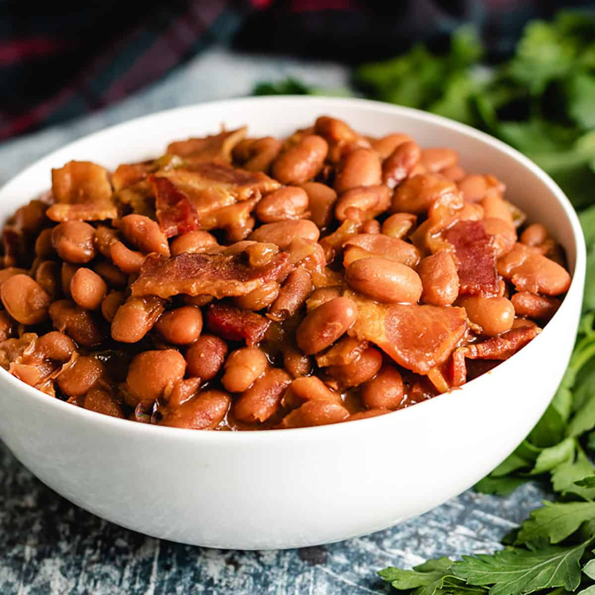 A white bowl filled with Instant Pot baked beans.