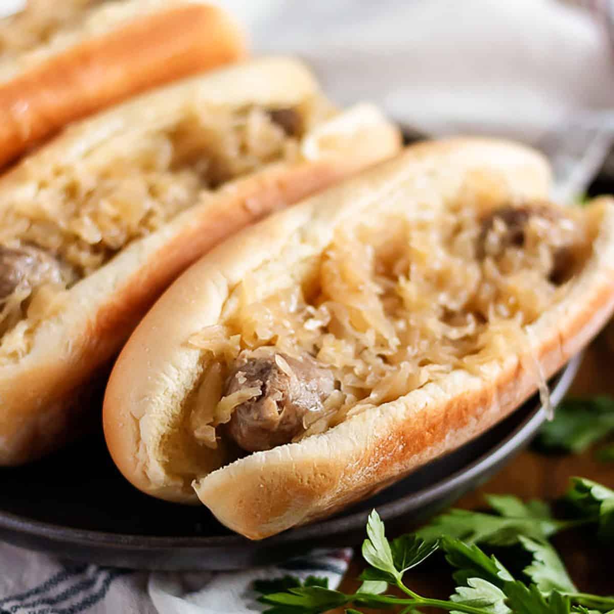 Bratwurst and sauerkraut in a hot do bun.