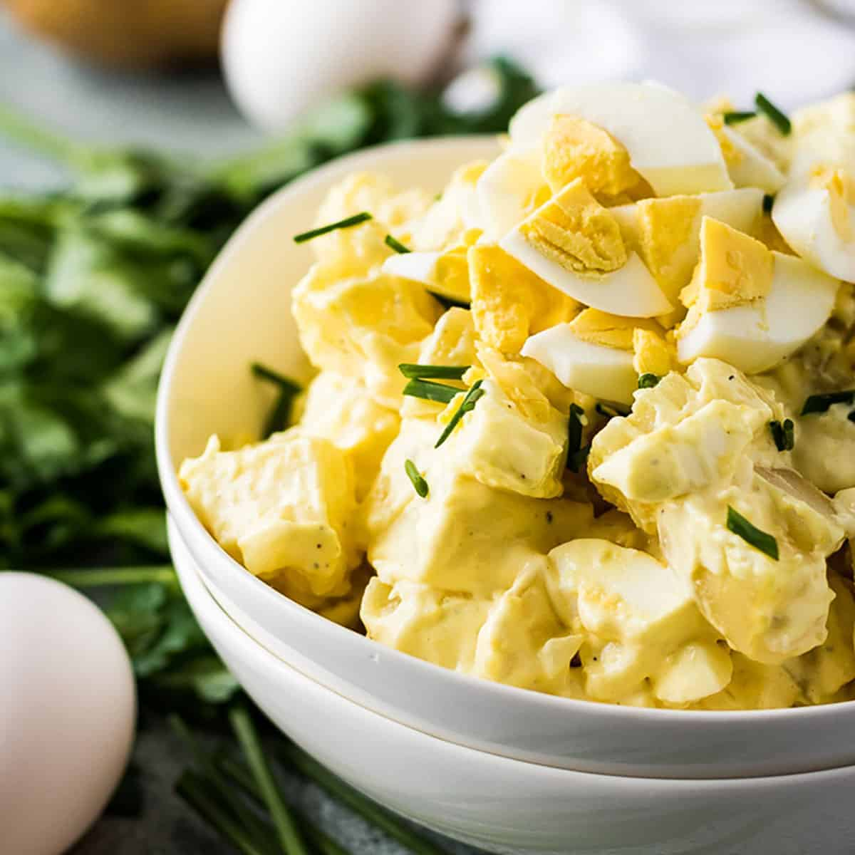 Instant Pot potato salad topped with chopped eggs and chives.