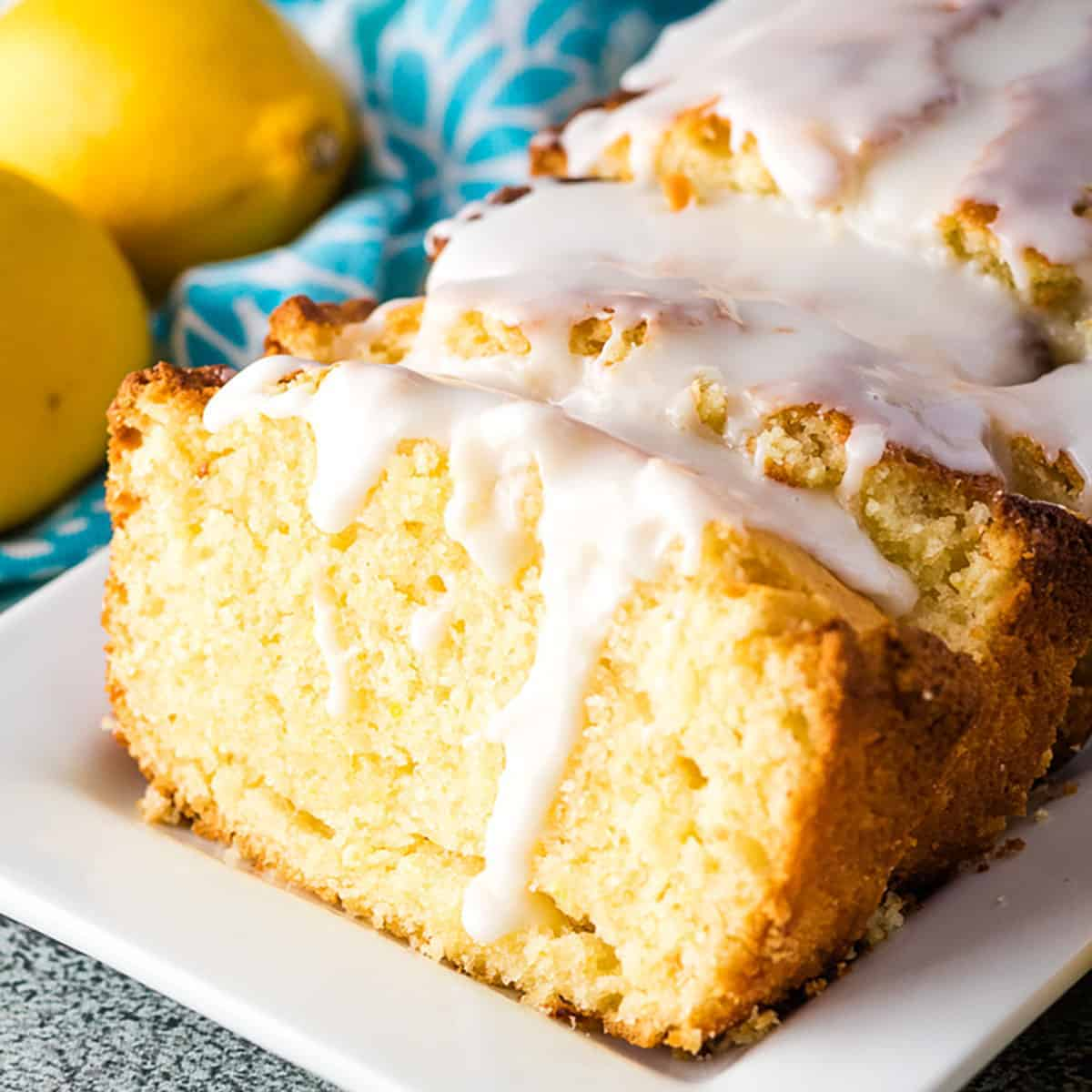 Slice lemon quick bread drizzled with a sweet glaze.