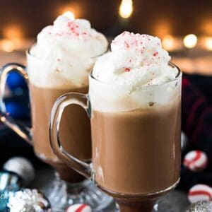 Two glasses of peppermint mocha coffee topped with homemade whipped cream.