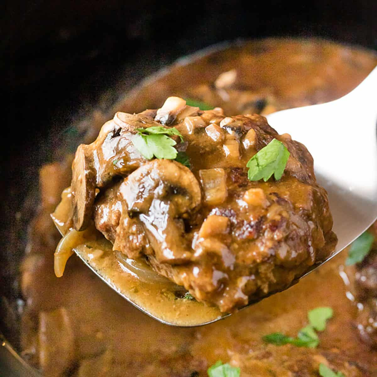 Salisbury steak with mushrooms over a slow cooker.