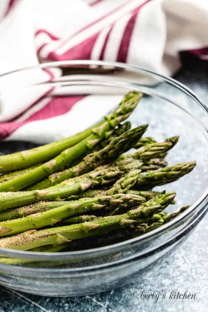 The trimmed asparagus in a mixing bowl.