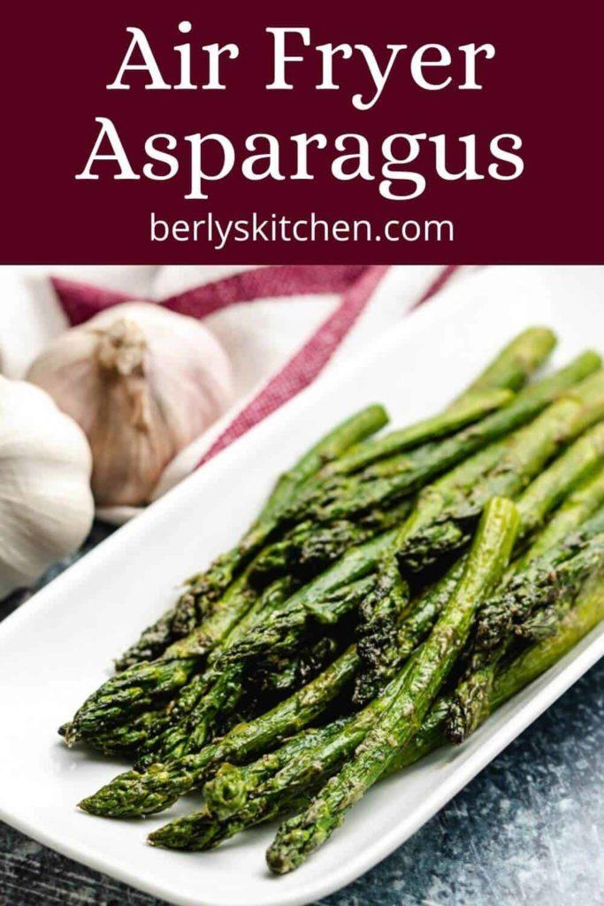 Seasoned air fryer asparagus on a decorative platter.