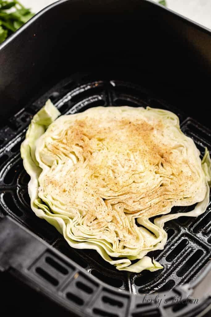 The cabbage steak placed into the machine.
