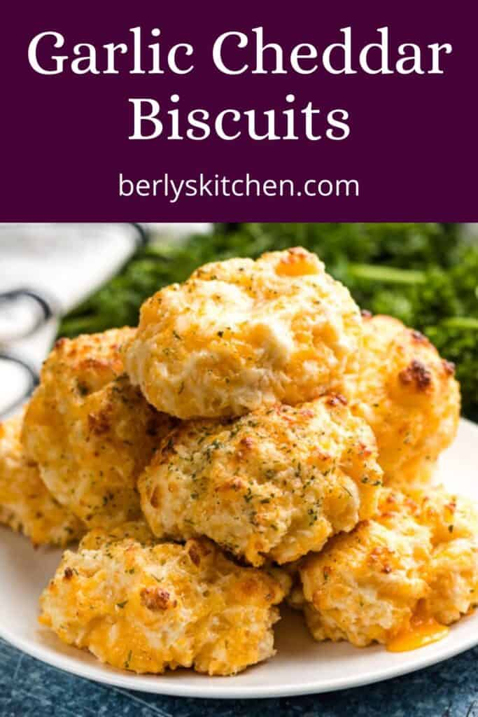 Garlic cheddar biscuits stacked on a plate.