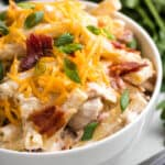 A close-up view of the salad topped with bacon and cheese.