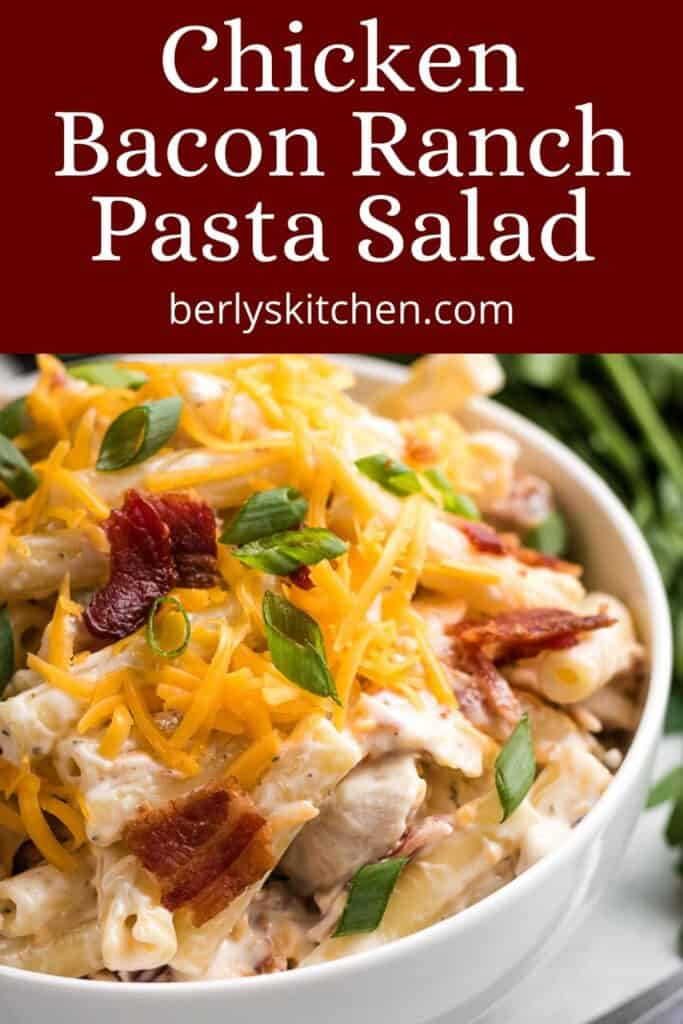 Chicken bacon pasta salad topped with bacon and cheese.