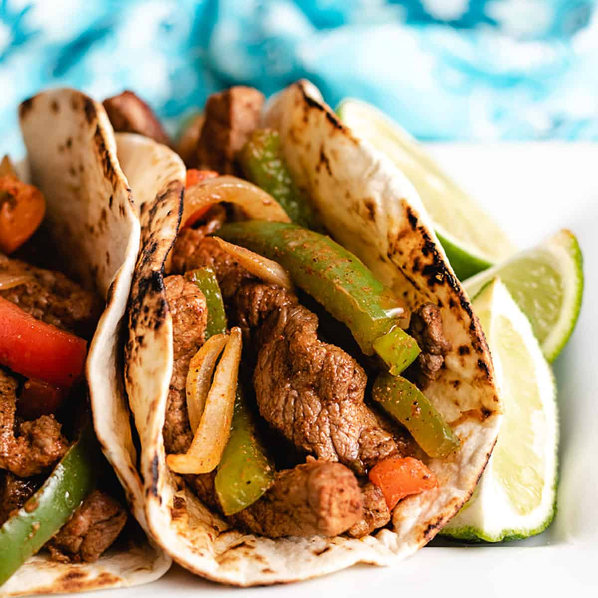 A close-up of the flat iron steak fajitas on a plate.