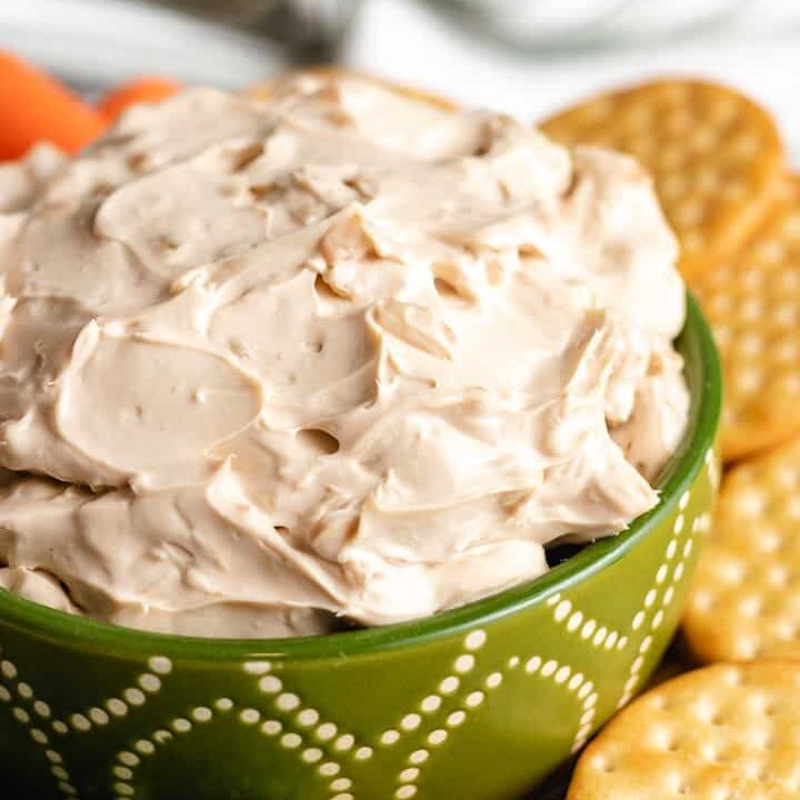 A close-up view of the creamy French onion dip in a serving bowl.