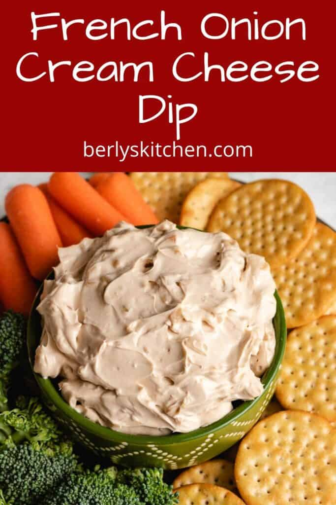 An aerial view of the cream cheese dip with crackers and veggies.