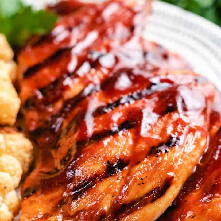 A close-up view of the finished chicken on a plate.