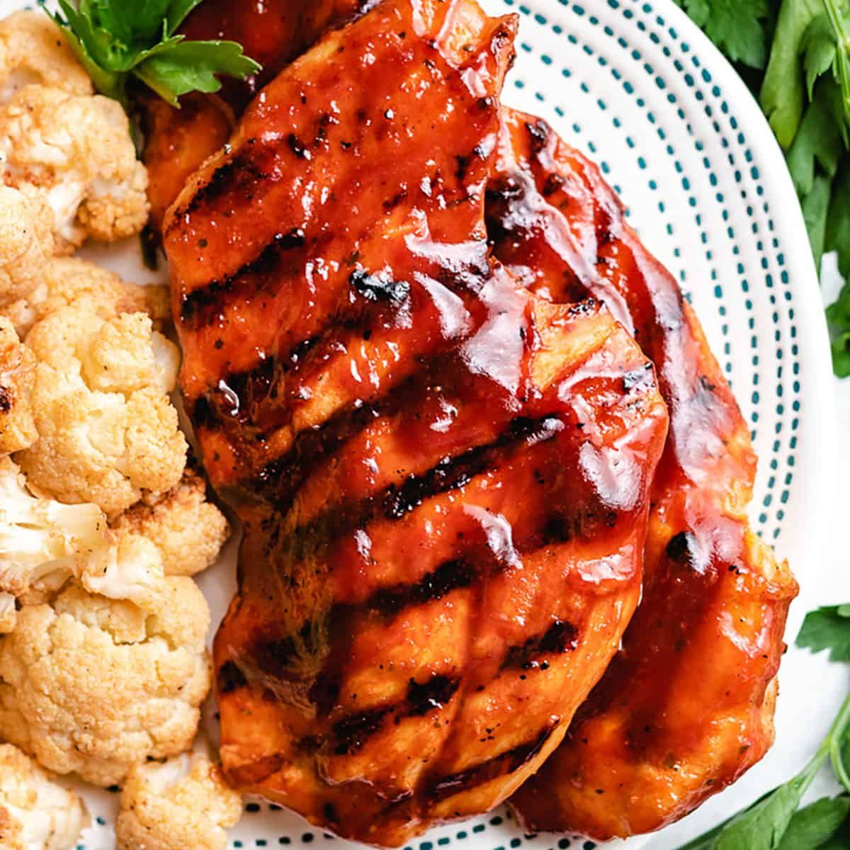 The grilled BBQ chicken breast served with cauliflower.