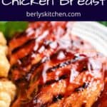 Close-up view of the grilled chicken topped with BBQ sauce.