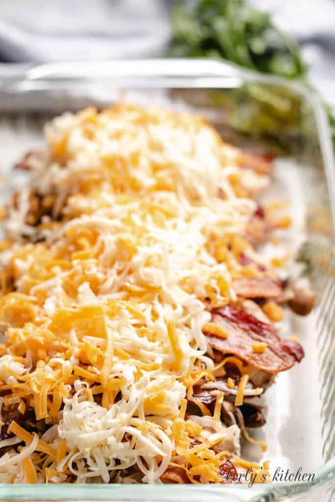Shredded cheese sprinkled over the bacon.