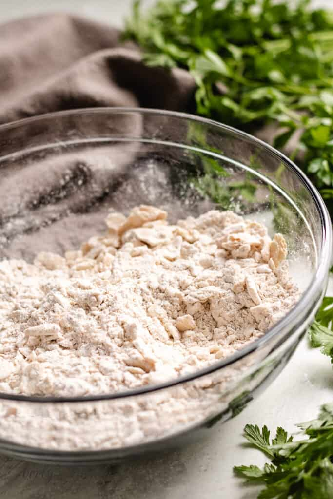 Crushed saltine crackers and spices in a mixing bowl.