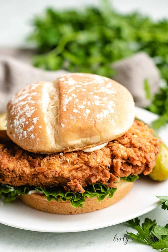 The finished fried chicken sandwich on a bun.